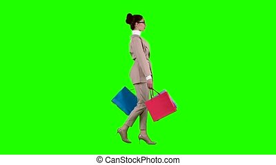 Girl goes shopping in the store. Green screen - Girl goes...
