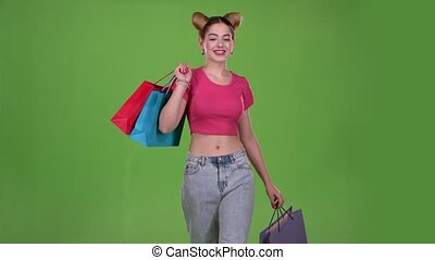 Girl goes shopping with bags in his hands. Green screen....