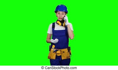 Girl goes to work and speaks on the phone she is an engineer. Green screen