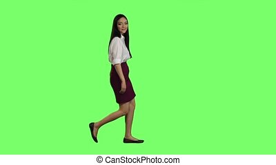 Girl goes to work and waves her hand. Green screen. Side view. Slow motion