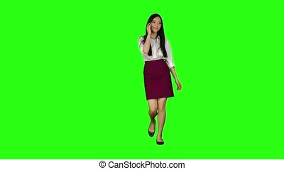 Girl goes to work, her phone rings, she starts to run. Green screen. Slow motion