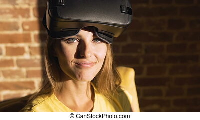 Girl Going to Use Virtual Reality Helm - Fair hair caucasian...