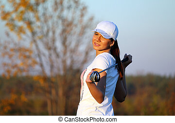 girl golf player outdoor portrait