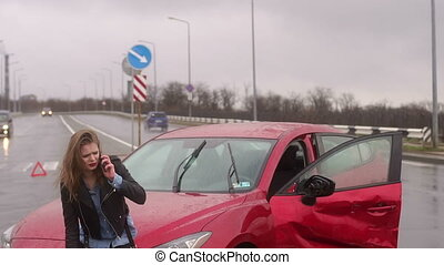Girl got into car accident on the road in the heavy rain, she talks on the phone