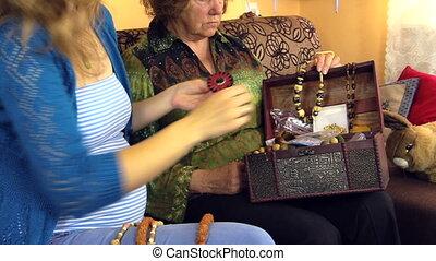 girl granny brooch box - granddaughter and nice grandma sit...