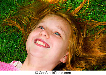 Girl grass - Portrait of a young girl relaxing on green ...