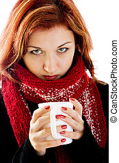 girl grimaces - portrait of girl in winter clothes with cup