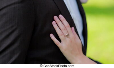 girl groom hand stroking his chest