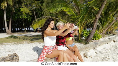 Girl Group Taking Photo Of Beach Landscape On Cell Smart...