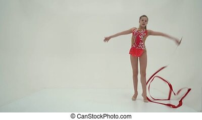 Girl gymnast performs exercises with tape. - Little girl ...
