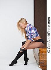 Girl gymnast. Young girl doing gymnastic exercises isolated