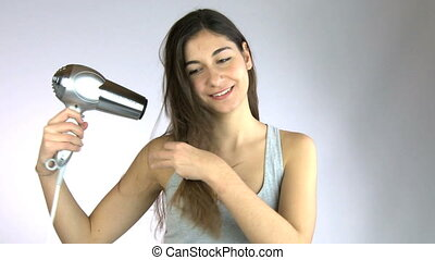 Girl hairfrying and smiling happy