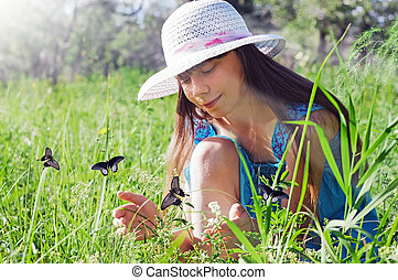 girl handed catches butterflies on a sunny day