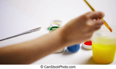 girl hands painting with gouache colour at home - people,...