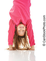 Girl hanging upside down - Little girl hanging upside down