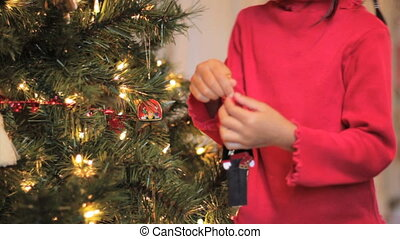 Girl Hangs Asian Christmas Ornament