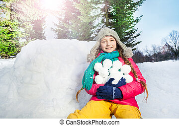 Girl have fun with snowball fight winter outdoor