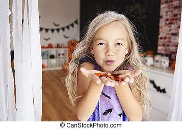 Girl having a fun with confetti
