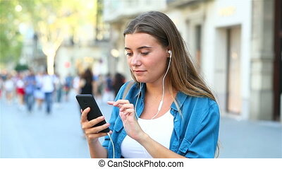 Girl having a video call in the street