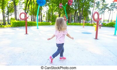 Girl having fun in amusement park - Adorable little girl...