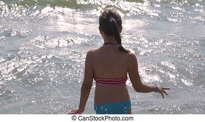 Girl Having Fun in Sea Waves
