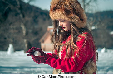 Girl having fun in the snow. Winter time