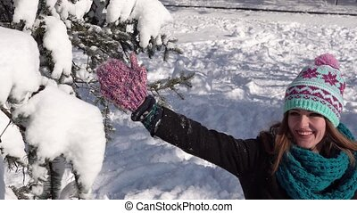 Girl Having Fun near Snow Tree