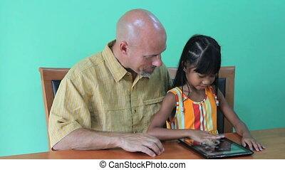 Girl Having Fun On Digital Tablet