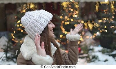 Girl Having Fun on the Street, Snowfall