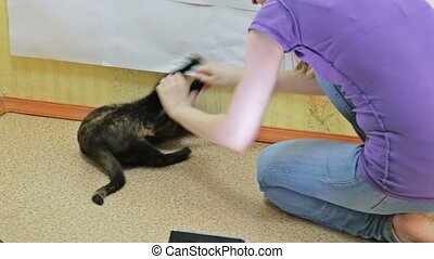 Girl having fun playing with her cat.