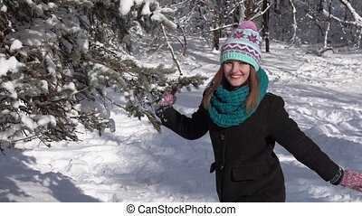 Girl Having Fun with Snow Tree