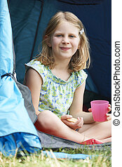 Girl Having Snack On Camping Trip