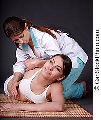Girl having thai massage.