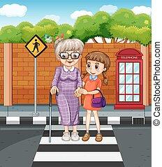 Girl helping grandmother crossing the street
