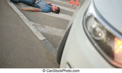 Girl helping injured in a car accident man. pedestrian injured in road accidents