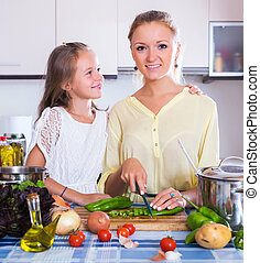 Girl helping mother to prepare - Cute little girl helping ...