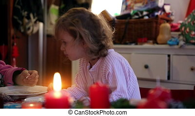 Girl helps decorating cookies on advent first - A little...