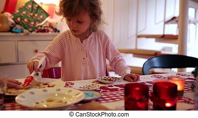 Girl helps her mother to make cookies on advent first