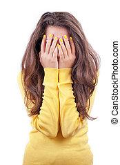 Girl hiding her face - Frightened girl hiding her face