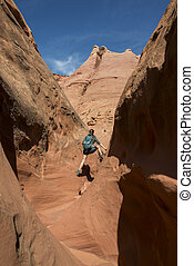 Girl Hiker Backpacker in the Slot Canyon