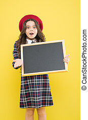 Girl hold blank blackboard. Advertising product copy space. Back to school concept. School information. Informing you. Expect the unexpected. Child promo information board. Place for information