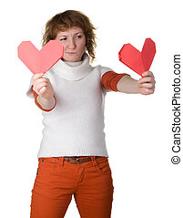girl holding 2 origami hearts makes choise