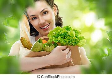 bag of food - girl holding a bag of food