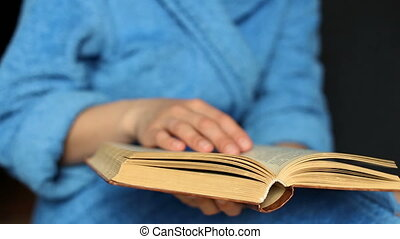 Girl holding a book, close-up