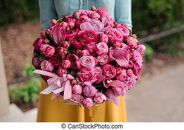 girl holding a bouquet of pink flowers