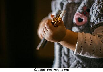 girl holding a brush