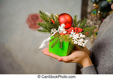 Girl holding a christmas green decorated gift box