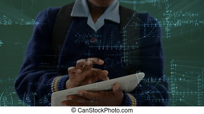Girl holding a digital tablet in classroom 4k
