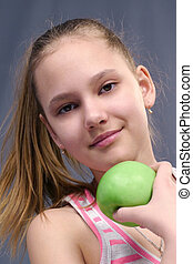 girl holding a green apple in hand