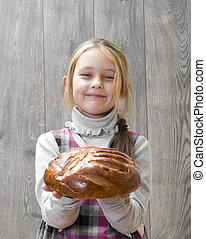 girl holding a loaf of bread